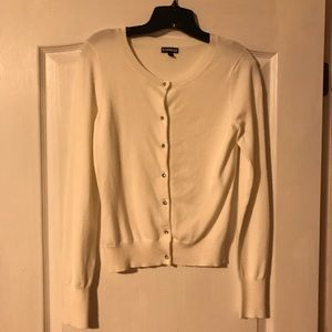 Cream color button up cardigan in size small.
